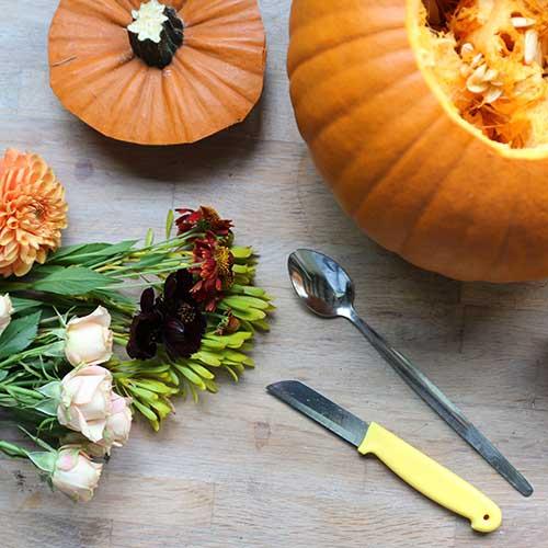 pumpkin full of autumnal flowers