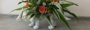 alternative wedding centrepiece flower dinosaur decor